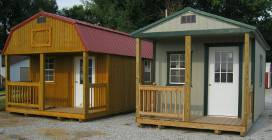 2 cabin-style portable buildings